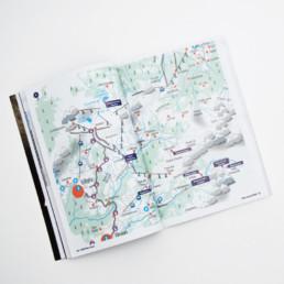 Guide, plan avec pictogramme. Bulles indicatives des buvettes en bleu indigo.