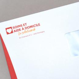 Conception graphique, enveloppe, logo la-solution.ch, Pictogramme coeur et typographie
